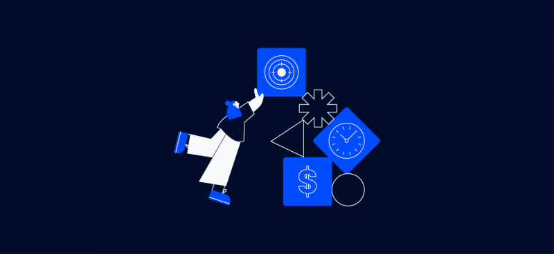 project manager holding up a stack of boxes with constraints in them, represented by a clock, a dollar sign, and a target